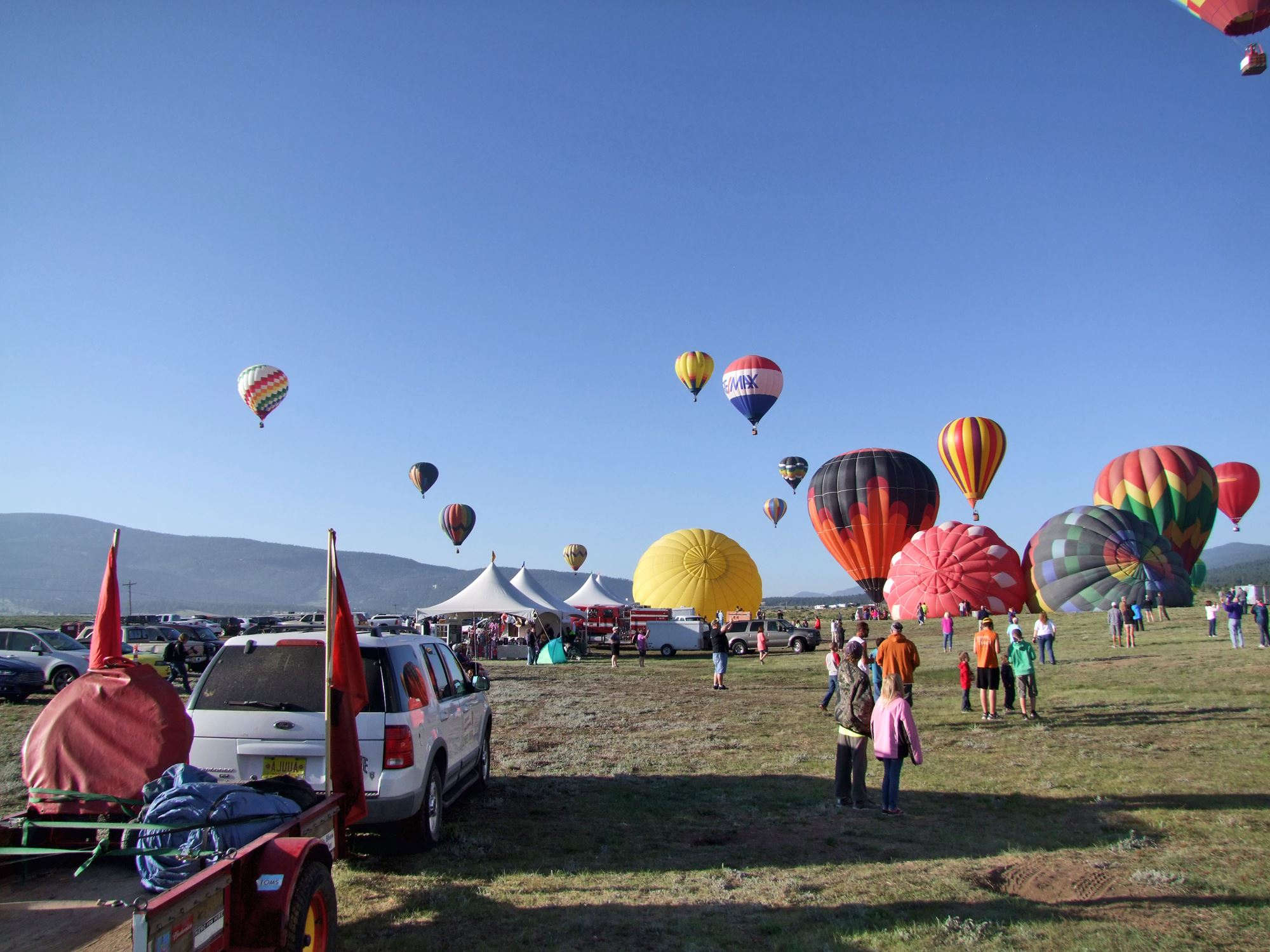 People on the Ground Watching Balloons