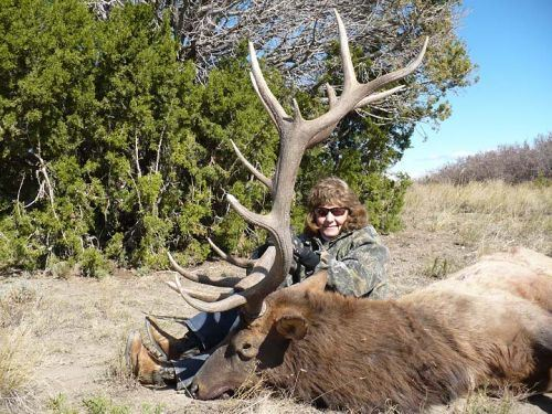Woman with Hunted Elk on the Ground